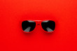 canvas print picture - studio shot of red sunglasses. summer is coming concept