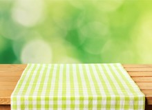 Green Cloth Napkin On Wooden B...