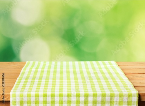 Green cloth napkin on wooden background
