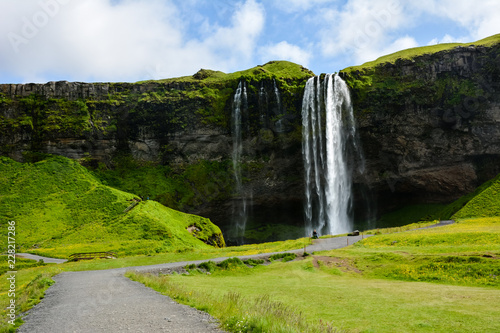Poster Green Seljalandsfoss waterfall, Iceland on a sunny summer day - uncrowded front view