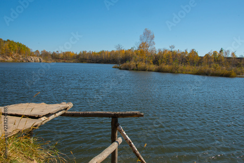 Foto op Aluminium Blauw the mountain autumn landscape with colorful forest