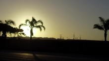 Driving Past A Silhouetted Total Petrol Station Along Settlers Way(R72) In East London, South Africa.