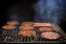 Cooking Burgers On Hot Coals With Smoke. Copy Space