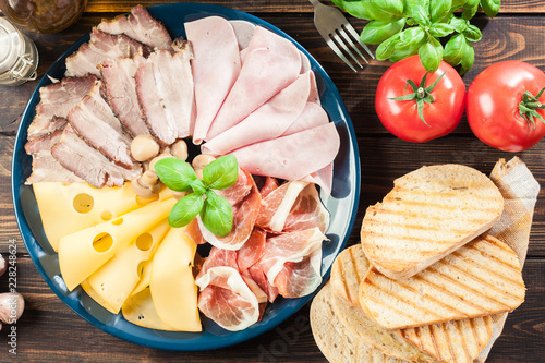 Poster Assortiment Cold meat platter with ham, prosciutto, bacon and cheese
