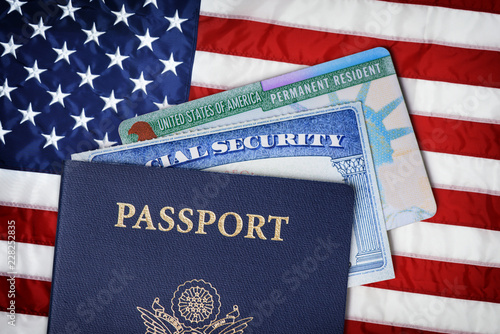 Valokuva  United States passport, social security card and resident card over american flag