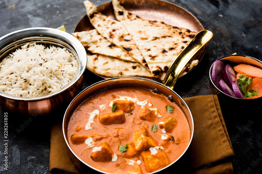 Fototapety, obrazy: Paneer Butter Masala or Cheese Cottage Curry in serving a bowl or pan, served with or without roti and rice