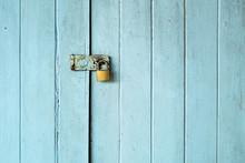 Old Padlock On The Vintage Retro Wood Door