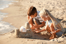 Cute Little Children Building Sand Castle On Sea Beach