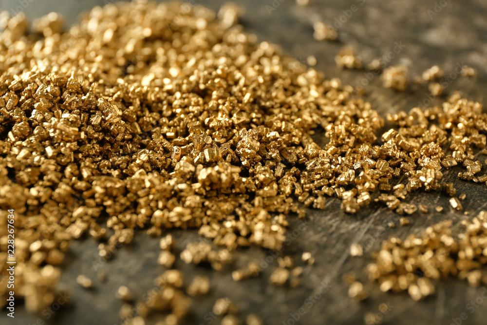 Fototapeta Many gold nuggets on table