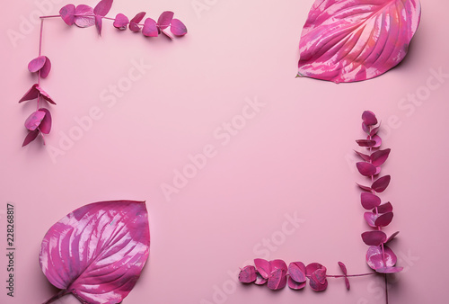 Foto op Canvas Bloemen Frame made of pink tropical leaves on color background