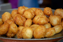 Bunyols, Buñuelos, Round Doughnuts Balls Made From A Potato Or Cassava Dough And Cooked In Hot Oil. Traditional Snack Popular In Spain And Latin America. Side View. Macro, Close Up.