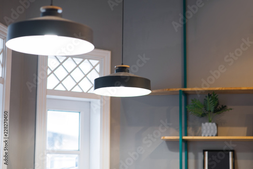Foto  Close-up of lamps in office or home with windows and shelves behind