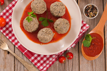 Fototapeta Meatballs with tomato sauce.