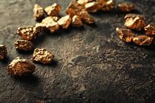 Gold Nuggets On Dark Background