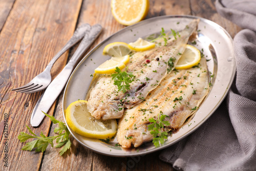 Fototapeta sole fish cooked with herb and lemon obraz