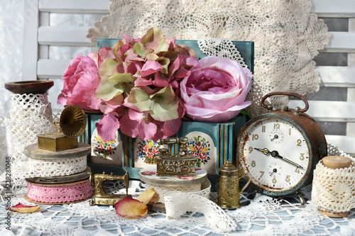 Fototapeta vintage style still life with collection of miniature iron stuffs and alarm clock obraz