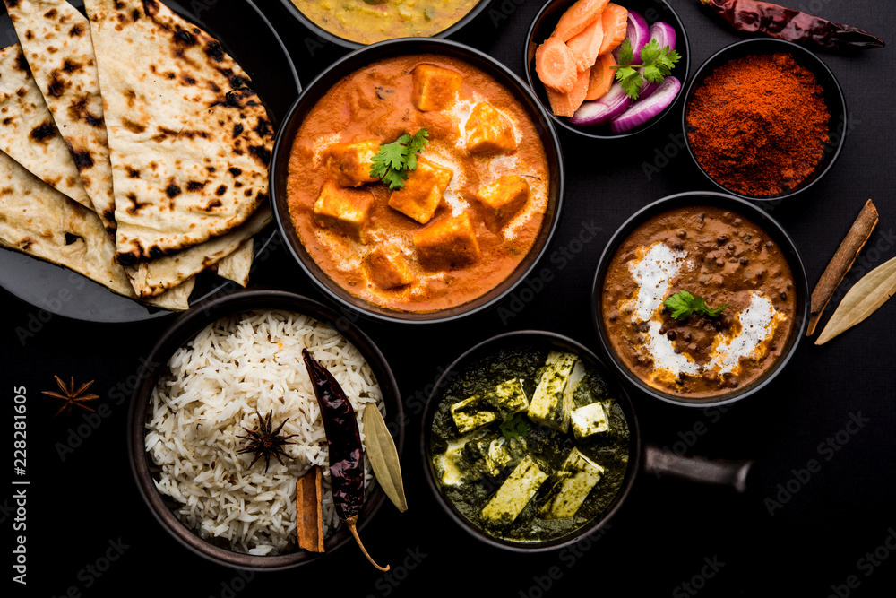 Fototapety, obrazy: Indian Lunch / Dinner main course food in group includes Paneer Butter Masala, Dal Makhani, Palak Paneer, Roti, Rice etc, Selective focus