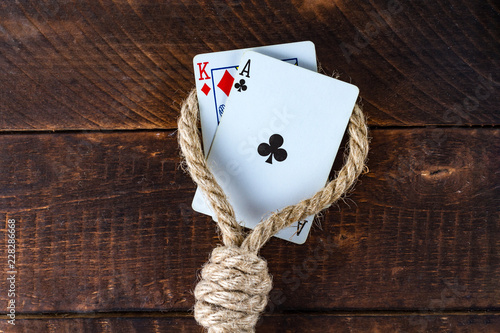 Foto  Card addiction. Dependence on poker. Gambling concept