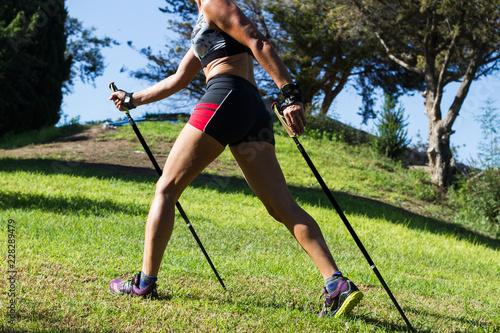 Mujer practicando nordic walking al aire libre Canvas Print