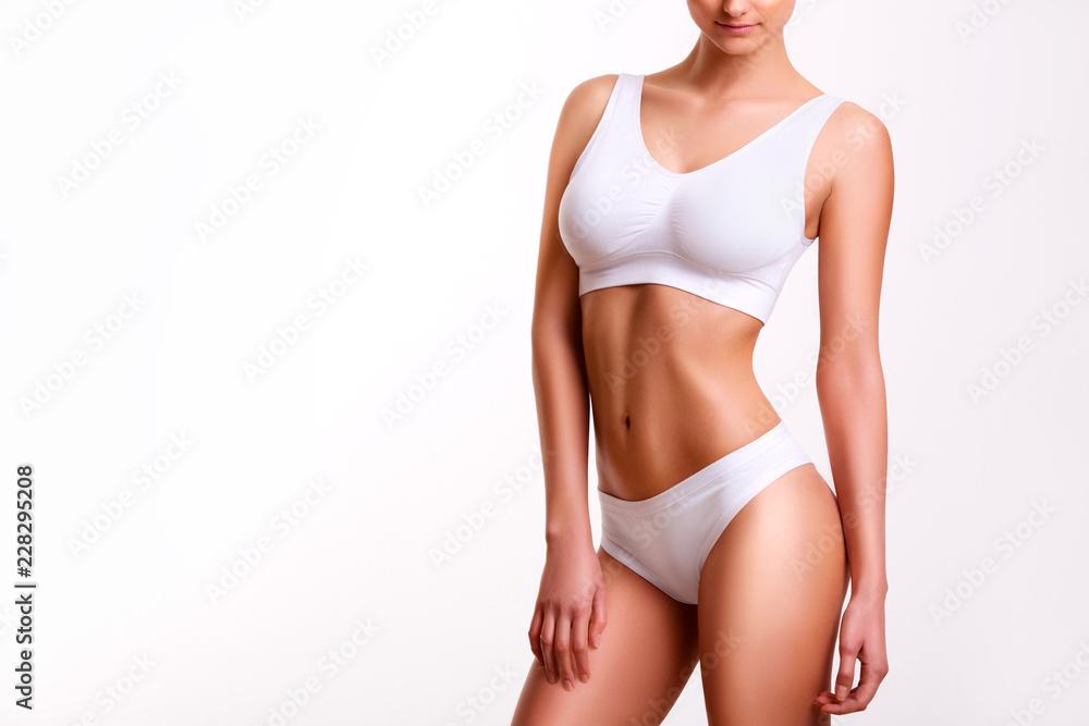 Fototapeta Woman beauty, body care. Slender line of a beauty young body in underwear. - obraz na płótnie