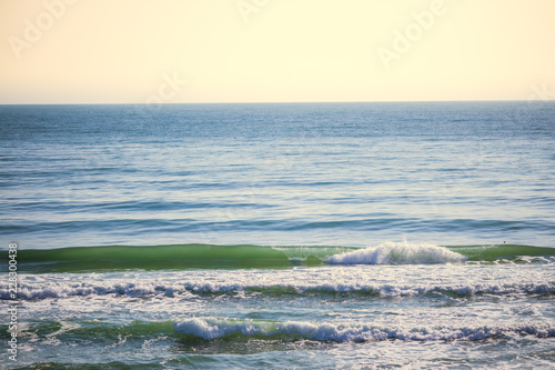 Sea and waves with clear sky on the beach