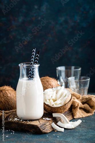 Fresh coconut milk in glass bottle, vegan non dairy healthy drink