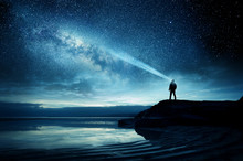A Person Standing And Watching The Milky Way Galaxy Rise Into The Night Sky. Photo Composite