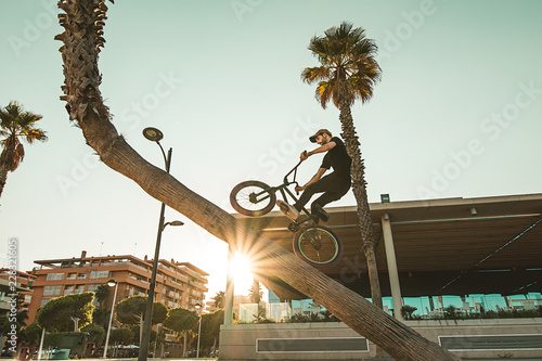 Guy riding and jumping with a bmx bike. Bmx freestyle