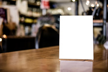 Mock Up Blank Menu Frame On Table In Coffee Shop Stand For Your Text Of Display Your Product