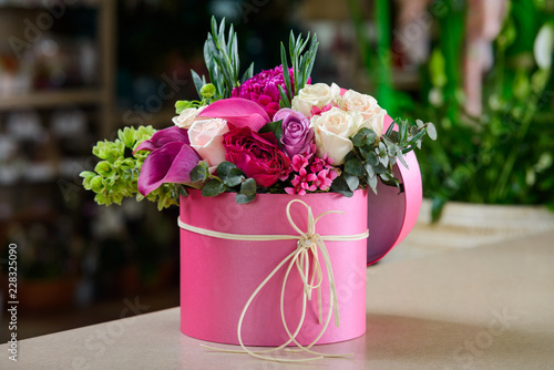 Pink box with flower bouquet