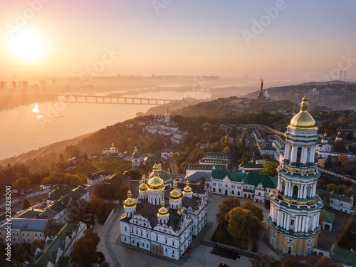 Foto op Plexiglas Kiev Most inetersting places of Kiyv Ukraine. Kiev Pechersk Lavra. Aerial drone photo. View to rider Dnipro and The Motherland Monument. Fog and sunrise light. Amazing view