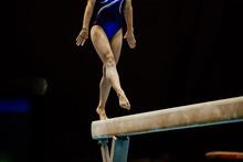 Female Gymnast On Balance Beam...