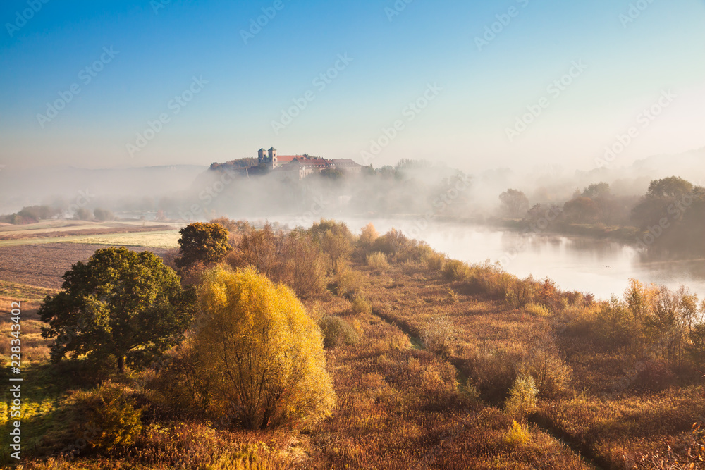 Abbey Tyniec surrounded by meandering Vistula river in colorful autumn scenery. Worth seeing nature reserve of Krakow