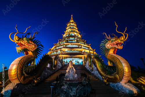 Wall Murals Place of worship Beautiful Chinese pagoda in the night at Hyuaplakang temple