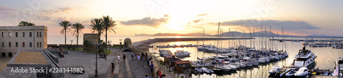 Photo Alghero, Italy - Panoramic view of the Alghero historic quarter and marina with St