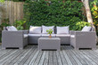Leinwanddruck Bild - Large terrace patio with rattan garden furniture in the garden on wooden floor.