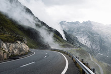 On A Road With Mountains In A ...