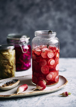 Radish Pickle In Jar On Plate