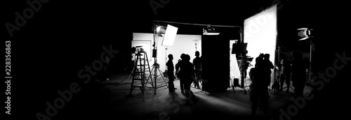 Fotografiet Silhouette images of video production behind the scenes or b-roll or making of T