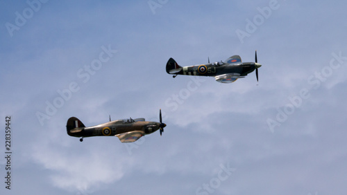 Fotografie, Tablou RAF World War 2 Spitfire (above) and Hurricane flying in formation