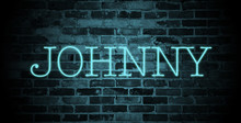 First Name Johnny In Blue Neon On Brick Wall