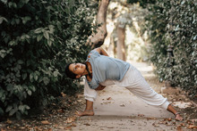 Anonymous Woman Doing Yoga In Autumn Park