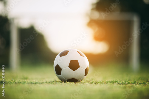 фотографія  A ball for street soccer football under the sunset ray light