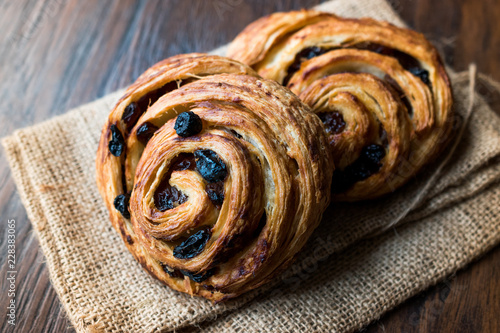 Tuinposter Brood Danish Spiral Cinnamon Raisin Roll / German Pastry Schnecken on Sack.