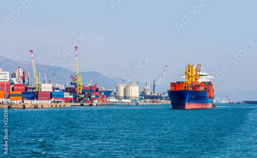 International Container Cargo ship in the port of genoa - Industrial port of genoa , italy