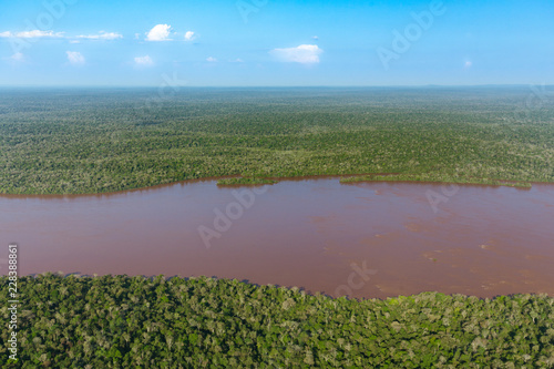 Foto op Canvas Khaki Top view of the Iguazu waterfalls, parana river and huge rainforest spaces.