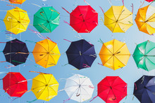 Colored Umbrellas Hanging Above The Street, Blue Sky