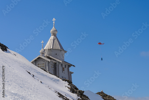 Foto op Aluminium Antarctica Wooden church in Antarctica on Bellingshausen Russian Antarctic research station and helicopter