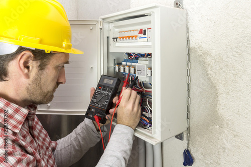 electrician at work measures the electric current Canvas Print