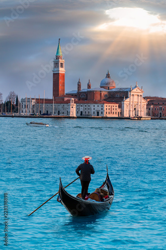 Panoramic aerial view at San Giorgio Maggiore island with gondola, Venice, Italy